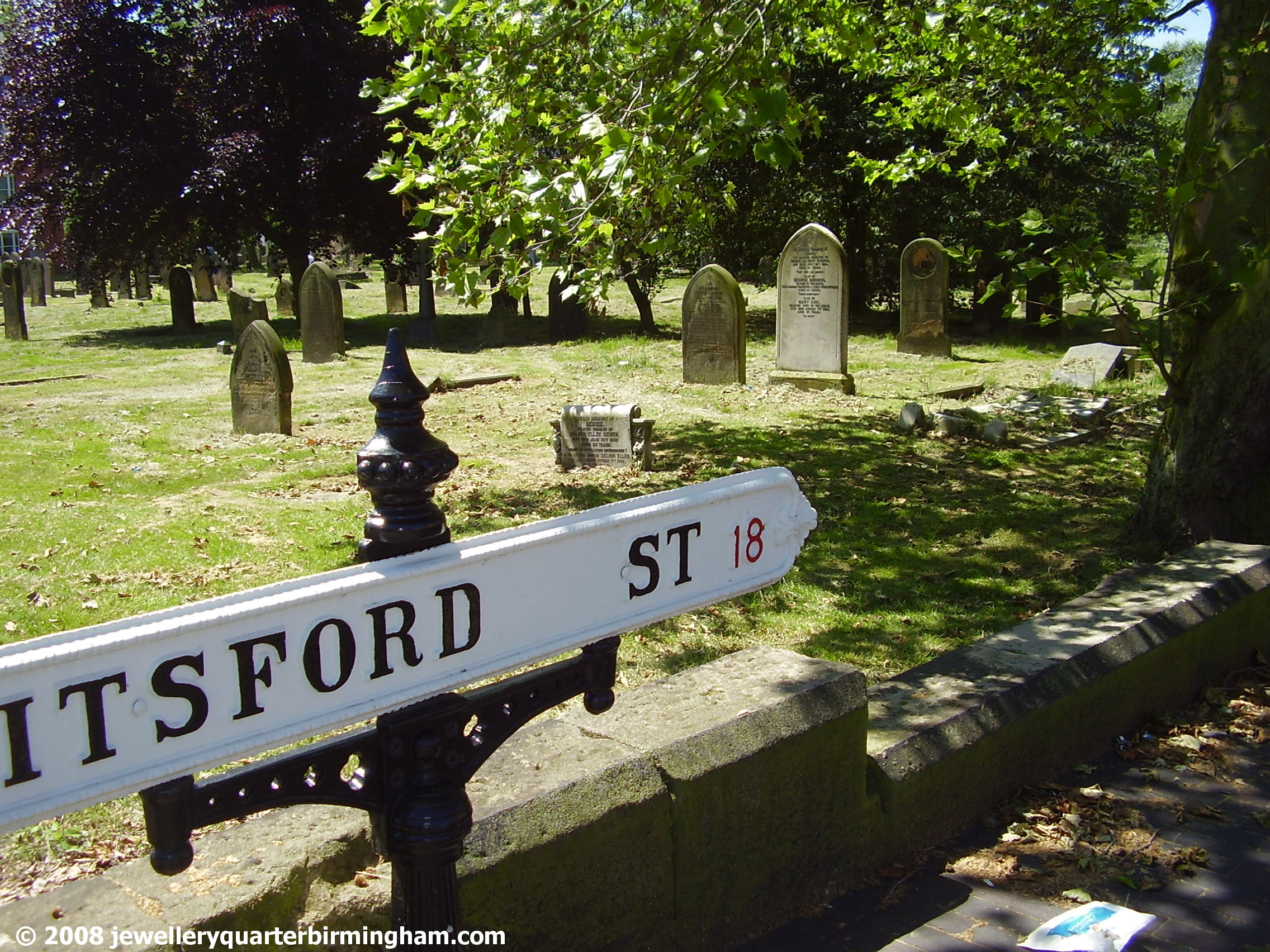 Walking-down-Pitsford-St-with-Mint-Cemetery-on-left.jpg 2008